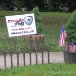 Mosquito Shield sign in yard